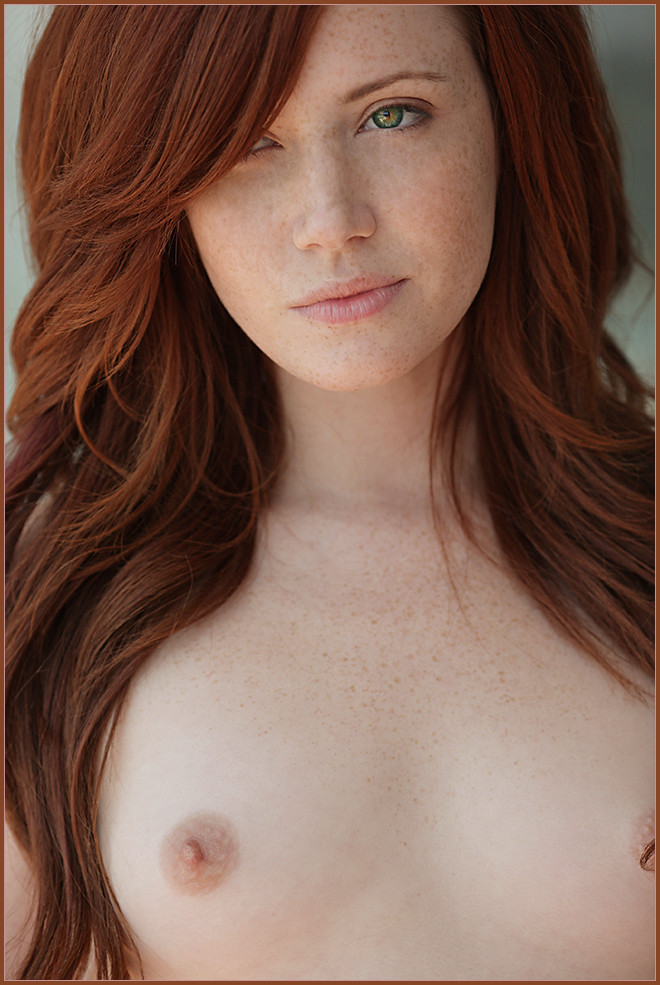 Amateur redhead with freckles glasses