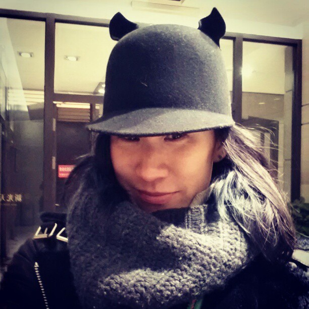 evachen212:  everyone in Hong Kong had hats with little ears on them and I made it my personal mission to buy as many (okay, one or two) of them as soon as I stumbled upon them. this is my first one… a wee bit ridiculous but I love it!   Want. Wantwantwant. I love anything having to do with headgear ears.