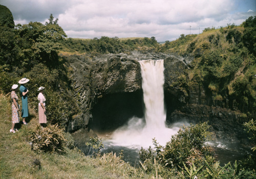 natgeofound:  Three women watch the rushing waters of Rainbow Falls in Hilo, Hawaii.Photograph by Richard Hewitt Stewart, National Geographic