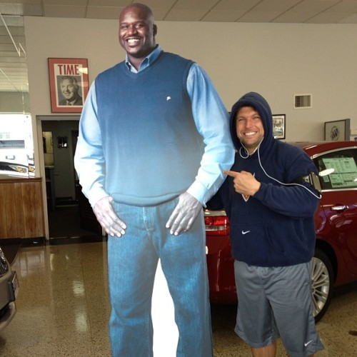 Holy Shit! I was riding my bike & I saw this in the Buick  window… @SHAQ cut-out in the sweater vest I bought him from when he came on my old radio show #Shaq #NBA