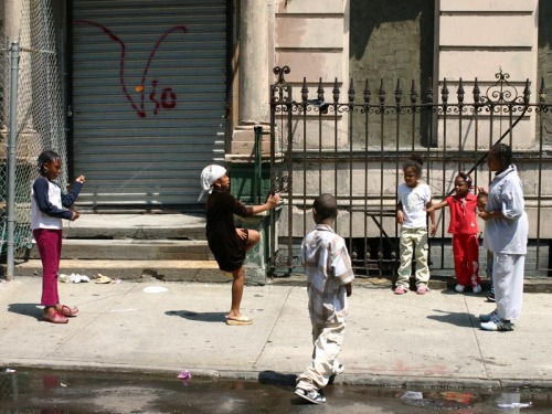 Children playing, around 138th Street and Lenox Avenue in Harlem. 15 May 2004.
