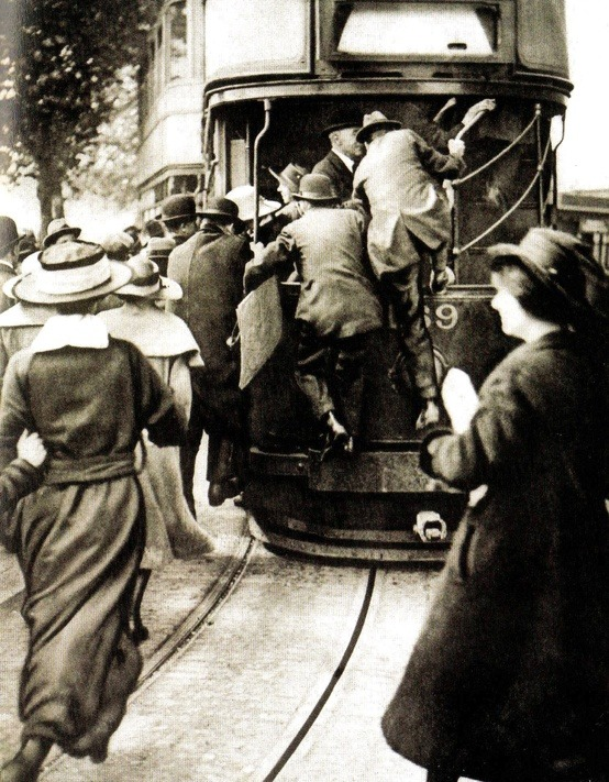 Passengers run for the tram during the National Railway strike of 1919.