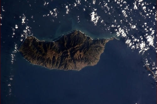 Madeira, Portuguese island off the coast of Africa. It parts the clouds.