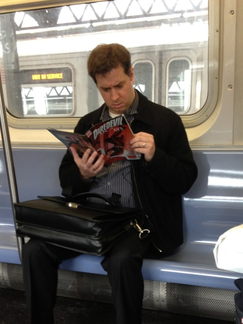 "brianmichaelbendis:  Man on morning subway commute reading Daredevil: End of Days.  Marvel editor Jen Grunwald took this photo on her way to work one morning… of this man really enjoying his new issue of our book. She immediately texted it to Brian Michael Bendis & myself in real time (we were still up). Brian and I were texting her while she was on the train trying to convince her to whisper to the man… ""Mapone""."