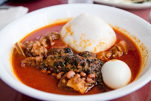 More Omotuo (Rice balls) with Groundnut and Palmnut soup with beans and lots of goat meat