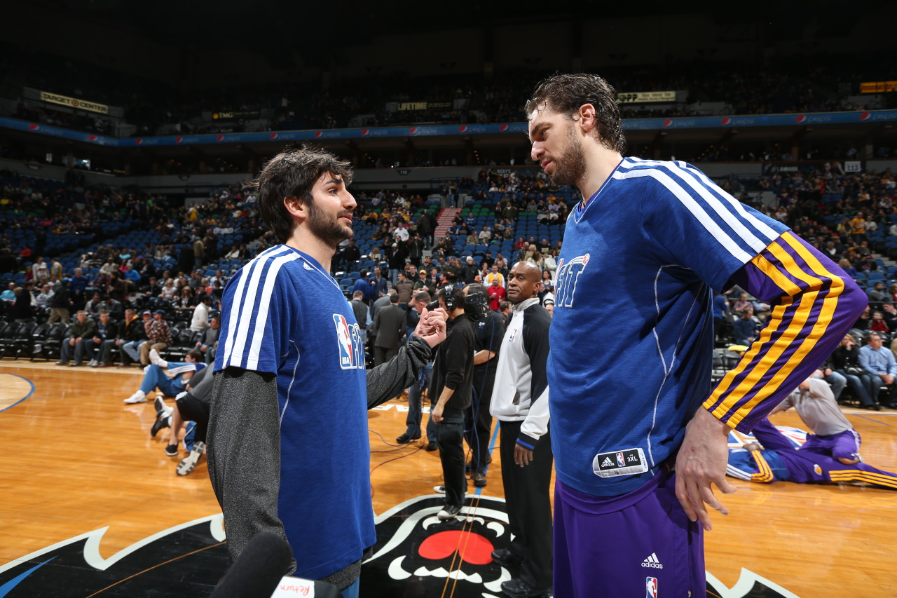 nba:  Ricky Rubio of the Minnesota Timberwolves speaks with Pau Gasol of the Los Angeles Lakers prior to their game on February 1, 2013 at Target Center in Minneapolis, Minnesota. (Photo by David Sherman/NBAE via Getty Images)  Ricky and Pau discussing what gift to give Javier Bardem and Penelope Cruz for their new baby shower.