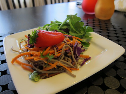 Soba Noodle Salad: Quick, One-pan Meal for Busy Weeks When I'm studying for a test or aiming to meet a deadline, the last thing I want to worry about is what to eat. I've heard sad stories from my classmates, one of which subsisted on string cheese and M&Ms during the days before one of our first exams. Some rely on fast, but expensive meals during finals or midterms week. As for me, I need something that's easy to clean up, packed with nutrients, and fast to make! That's what makes this Soba Noodles recipe great for anytime you need to save time! It's entirely plant-based, vegan, high in protein, and rich in vitamins. Ingredients (4 servings): 1 pack of Soba Noodles (I like Hakubaku's Organic Buckwheat Soba Noodles) 2 cups Carrots (shredded) 2 cups Red Cabbage 1 sliced red Bell Pepper 1 cup shelled Edamame beans 4 spring onions (sliced) 4 tablespoons crushed, roasted peanuts for garnish (optional)  Parsley for garnish Dressing: Soy Chili Sauce ½ cup soy sauce 2 tablespoons rice vinegar 1 teaspoon chili powder  1 tablespoon sugar (optional) 1 tablespoon fresh, grated ginger Juice of 1 lime (adapted from http://www.saveur.com/article/Recipes/soy-chili-sauce) Directions:  Submerse dry soba noodles in boiling water for 4 minutes. Then, rinse with cold water and drain well. Toss chilled soba noodles with carrots, red cabbage, bell pepper, edamame beans, and onions. In a separate bowl, combine the soy sauce, rice vinegar, chili powder, sugar, and ginger. Top with lime juice, parsley, and peanuts.  What's great about this basic recipe is that it's extremely modifiable. If you don't like cold noodles, or the vegetables taste too raw, you can easily sautee the mixture in sesame oil. Also, the dressing can be whatever you're craving! I've tried topping the dish with curry sauce, soba sauce, and sesame-ginger salad dressing so far. Not only are you getting a major dose of protein from buckwheat and edamame beans, but you're getting a serious serving of vegetables as well. This meal will keep you energized and satisfied for lunch or dinner so you can stay strong and focused. Send me your thoughts! Geraldine