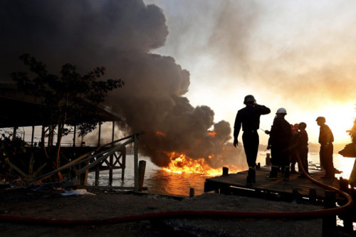 Nyein Chan Naing—EPA  Feb. 4, 2013. Fire fighters attempt to extinguish a fire at the jetty during the explosion on a tanker carrying diesel fuel at the Hlaing River, Yangon, Myanmar. Read more: http://lightbox.time.com/2013/02/08/pictures-of-the-week-february-1-february-8/#ixzz2KXnvOBkN