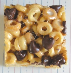 Peanut Butter Cheerios Treats  6 cups Peanut Butter Cheerios 2 Tablespoons butter 1/3 cup smooth peanut butter 10 ounces (approx. 40 ) regular sized marshmallows 1 cup chocolate chips Prep a 9×13 pan by greasing it with butter. In a pot over medium high heat melt the butter and peanut butter. Add in the marshmallows until you get a nice gooey mess.  Turn the heat off and add the Peanut Butter Cheerios and stir to combine making sure all of the cereal gets coated. Press into the prepped pan and while the cereal is still warm, sprinkle the chocolate chips on top so they melt slightly.  Let cool and cut into squares. These taste best if served the same day.