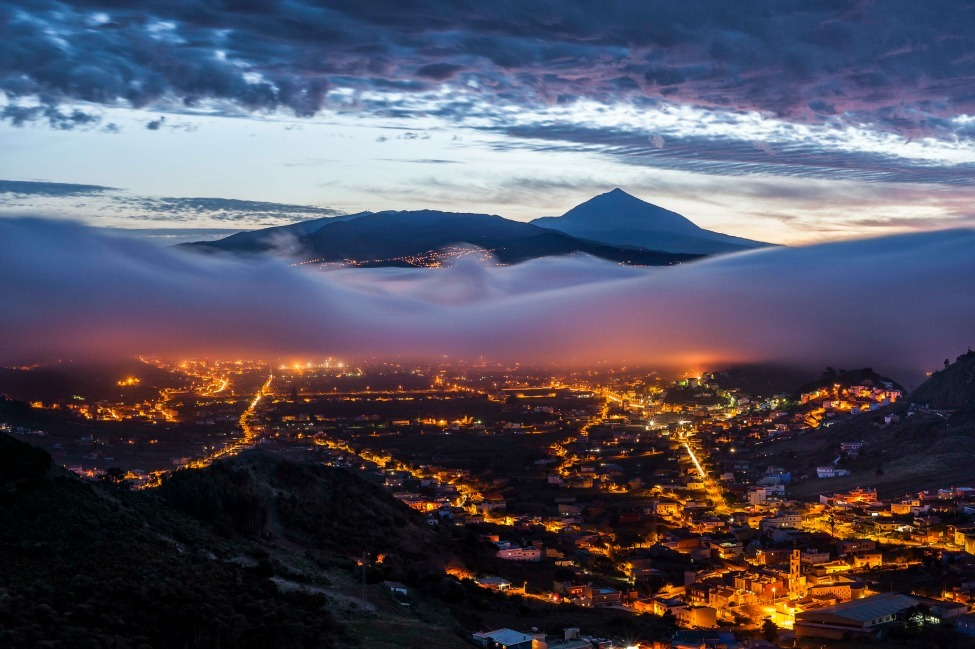 Photo of the Day: Teide volcano peeks out over fog hovering above the Spanish city of San Cristóbal de La Laguna Photo by Daniel Cejudo (Santa Cruz de Tenerife, Canary Islands); Tenerife, Spain