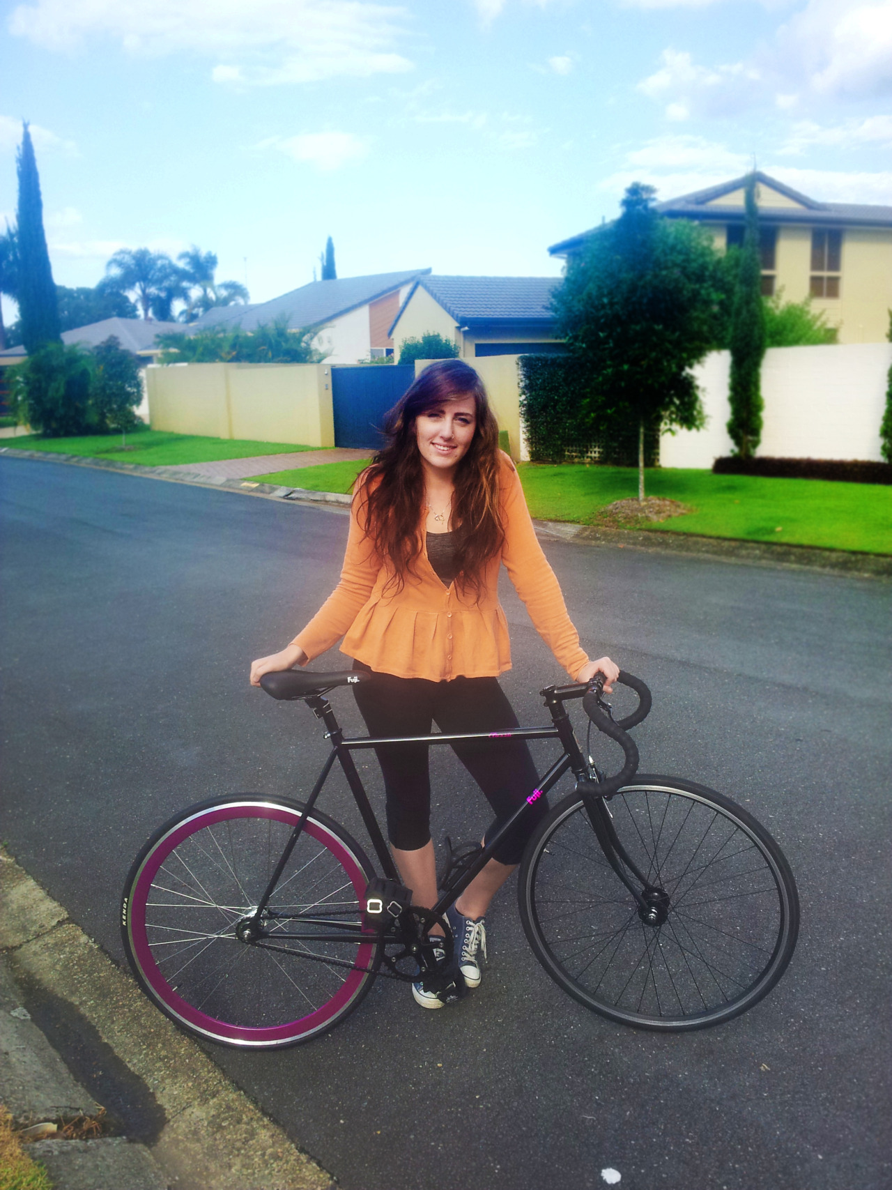 titsandtires:   this is my girlfriend hayley and her 2012 fuji classic track. she runs a 46:15 ratio fixed.  ed: high five bro