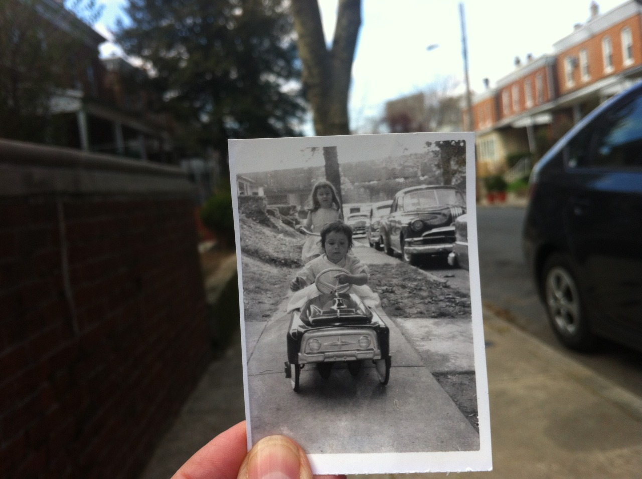 Dear Photograph,I traveled with you  2,807 miles to a street in Philadelphia where we took an imaginative leap back 52 years, 2 months and 3 days to my 4th birthday with my friend, Jenny. Having been away a long time, I didn't recognize much, but the determined girl peddling the fire truck is still me.  Ring the bell, she's on a mission!Cindy