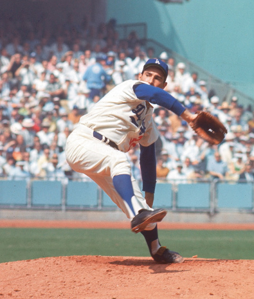 siphotos:   Dodgers hurler Sandy Koufax unleashes a pitch during the 1966 World Series against the Orioles in the 1966 World Series. (Herb Scharfman/SI)