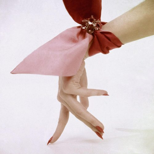 vogueaustralia: Pink wrist scarf photographed by Clifford Coffin in 1951.