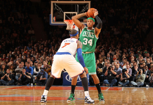 nba:  Paul Pierce of the Boston Celtics aims over Carmelo Anthony of the New York Knicks on January 7, 2013 at Madison Square Garden in New York City. (Photo by Nathaniel S. Butler/NBAE via Getty Images)  I enjoy how you can see Aziz courtside in the front row on the right edge of the photo.