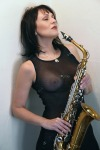 Musicandnude holding the alto sax le sax by @nakedsax
