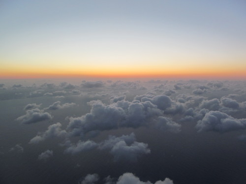 earthlaughsin-flowers:  i took this from an airplane, it looked like the sea and the sky swapped