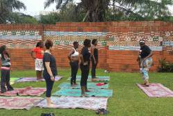 'When you dance you connect with the earth'. @fitcliqueafrica leads a morning yoga session at the AWDF convening. #HOLAAfrica #ArtCultureSports #AfriFemCulture #AfriFemArts