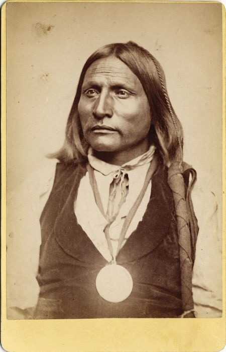 Big Bow … renowned Kiowa warrior and chief, he often lived and traveled with the Quohada Comanches. He enhanced his reputation through expeditions against the faraway Navajo and Ute tribes with whom he seemed to have held a grudge. He often went on raids alone or accompanied by one or two Mexican captives. It was said his high rank was indicated by his leggings that were fringed with human hair.