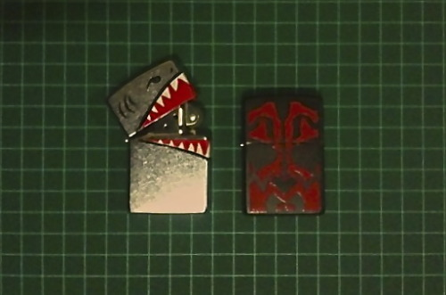 Custom painted my Zippos! X2 Pyro's Shark lighter and Darth Maul face tattoo.