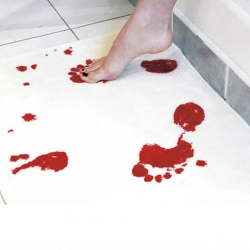 9gag:  Bath mat that turns red when wet!