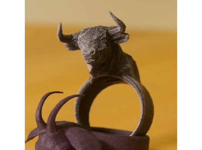 The Minotaur Ring designed by Bits to Atoms and 3D Printed in the material of your choice, on demand by Shapeways. Inspired Minotaur by The Drones http://www.youtube.com/watch?v=YX34Lxcj5J8&feature=player_embedded Standard size is US 11/34 66mm circ 21.24 diam Personalized to your exact specifications on demand. Bits to Atoms is a range of unisex, bespoke 3D printed jewelry. Range includes rings, pendants, broaches and earrings.