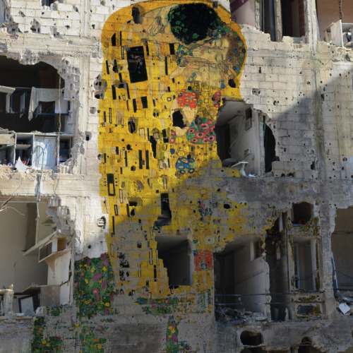 art-and-fury:  2headedsnake:  Tammam Azzam, Freedom graffiti  'Kiss' by Klimt painted on the remains of a building hit by bombs and bullets.