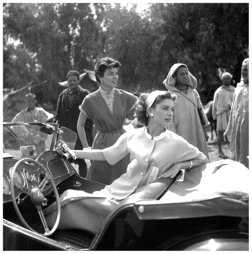 Women With the Top Down update: Wouldn't you like to know what Suzy Parker, the legendary redhead from Texas, is shooting with that little camera as she scoots around Ceylon in a 1951 MG TD? photo by Georges Dambier
