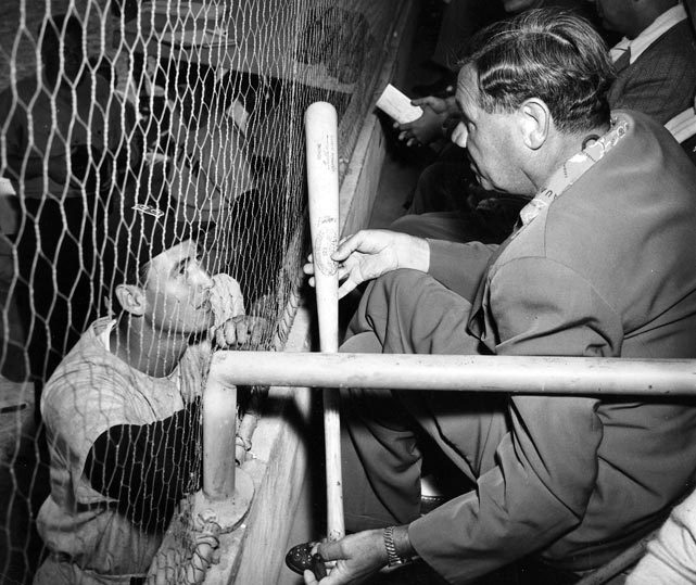 Ted Williams receives some hitting advice from Babe Ruth during a 1948 spring training game. (Icon SMI) GALLERY: Classic Photos of Babe Ruth