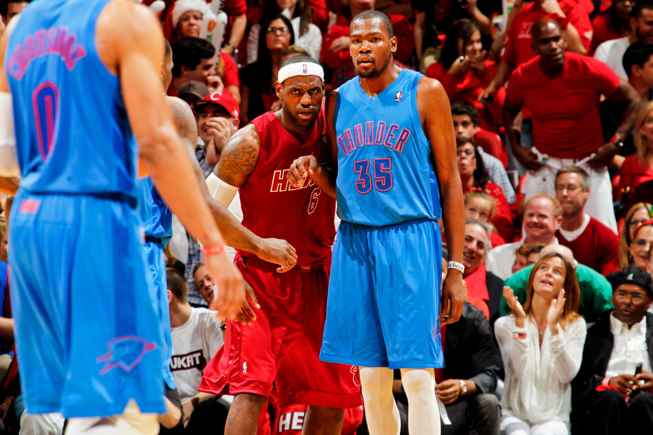 nba:  LeBron James of the Miami Heat defends against Kevin Durant of the Oklahoma City Thunder during a Christmas Day game on December 25, 2012 at American Airlines Arena in Miami, Florida.  (Photo by Issac Baldizon/NBAE via Getty Images)  #BIGcolor