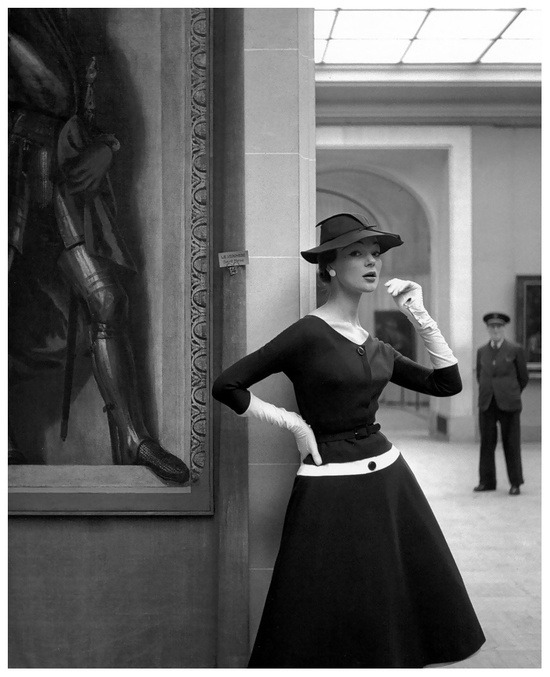 VintageSilhouette  Ivy Nicholson wearing a wool jersey dress by Jacques Fath for Elle magazine, 1954. Photo by Georges Dambier. ( via theniftyfifties )