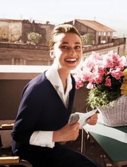 Audrey Hepburn on the terrace of the Hotel Hassler, in Rome, with the telegram announcing her best-actress award, for The Nun's Story, from the New York Film Critics Circle, 1960.