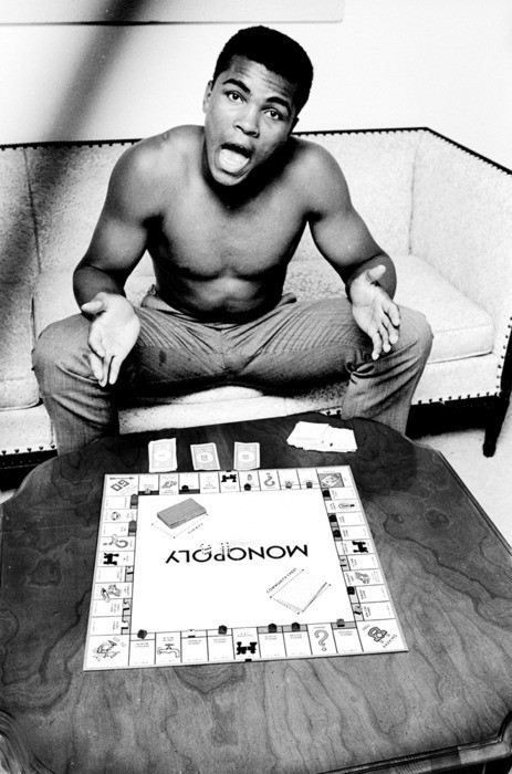 weirdvintage:  Muhammad Ali playing Monopoly, 1963 by Steve Schapiro