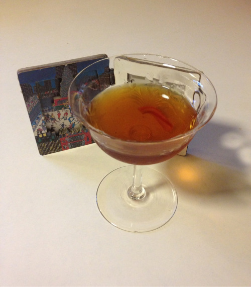 Ice Skating at Rockefeller Plaza* 2 oz candy cane bourbon 1 oz sweet vermouth 2 dashes cardamom bitters Combine all ingredients and stir with ice until well chilled. Strain into a cocktail glass and garnish with a small candy cane section. *Christmas in [a] Manhattan.