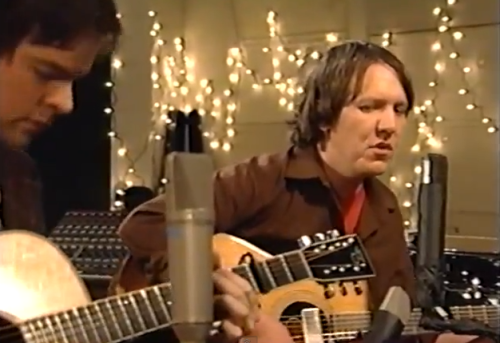(via Watch a lost Elliott Smith performance directed by Paul Thomas Anderson) Back in 2000 now famous director Paul Thomas Anderson helped directed a pilot for The Jon Brion Show. The show never got picked up but this footage of Elliott Smith playingSon of Sam, Everything Means Nothing To Me, Lennon's Jealous Guy, and more has now surfaced. WATCH HERE