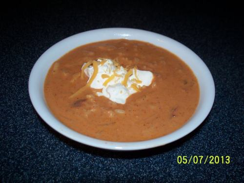 "John Soules Foods fan Marie Alexander Hanna shared this delicious recipe with us and we had to pass it on! Chicken Enchilada Hash Brown Soup Recipe""Gluten Free""Ingredients: 4 strips bacon 8 oz. John Soules Foods Chicken Fajitas, thawed 1/2 c. onion, chopped 8 oz. pkg. cream cheese, softened  19 oz. can mild enchilada sauce, red, divided 8 oz. sour cream 2 - 18.5 oz. cans Progresso Chicken Cheese Enchilada Flavor soup 26 oz. bag of frozen, shredded hash browns  2 - 14.5 oz. cans of chicken broth ½ tsp. cumin Salt & pepper, to taste Toppings: Reserved bacon ½ c. shredded cheddar cheese 1/8 c. green onion, chopped ½ c. sour cream  Directions: In large pot fry bacon till crispy. Remove to plate, crumble; reserve for topping soup. Leave 1 T. drippings in pan; brown chicken. Remove to plate. Brown onion in pot. Cut chicken into bite-size pieces. Put chicken in pot with onion. Add cream cheese and 1 cup enchilada sauce in with chicken. Stir over medium heat until melted. Add sour cream; stir well. Add remaining enchilada sauce; mix well. Pour in Progresso soup; stir. Add hash browns; heat on medium/high heat. Stir in chicken broth, cumin, salt and pepper, to taste. Bring to a slow boil; stirring often. Cook on medium/low 45 minutes; stirring occasionally. Ladle soup into bowls; top with reserved bacon, cheddar cheese, green onion and sour cream."