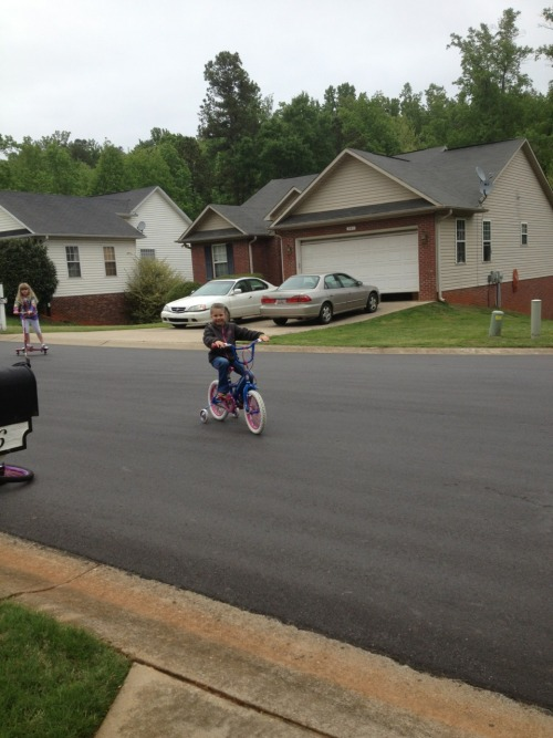 Bike riding!  After probably 2-3 years of trying to get her to ride a bike, buying her new ones because she grew out of her old, and almost forcing riding the bike on her, we gave up on her!  However, when she was here for the weekend, she got embarassed that her friends could ride and she couldnt. So she asked daddy to help her, and she whined and cried that she couldn't do it, but she kept on! This was her on Saturday riding by herself. Training wheels are still on because she's scared of the fall, but at least we have progress.   I hate to be mean to her about it, but such a big part of my childhood was being able to ride off on my bike with my friends. Even if I wasn't allowed to go far, we had a park and some trails we rode on. Only concern I have is the fact that SC and GA don't feel the need to have sidewalks. Why? This requires my kids to walk in the street. Sounds pretty stupid to me…  Anyways, YAY! For Katlyn!!