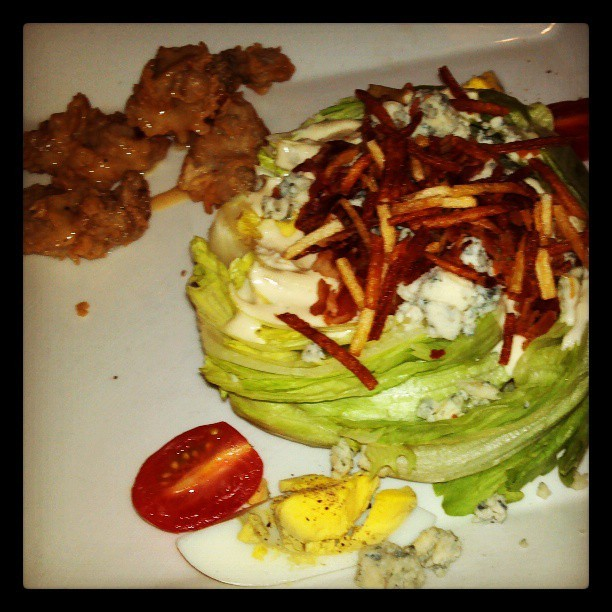 The perfect wedge salad, with lagniappe of fried ersters. I repeat: my life does *not* suck. (at Eurasia Cafe & Wine Bar)