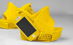 tuaw:  3D-printed shoes complete with iPhone holster. Because why not.