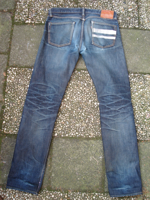 "MOMOTARO VINTAGE TAPERED (9 Months, 1 Wash) - Japan Blue x Momotaro ""Going to Battle"" 14.8oz Vintage Tapered raw selvedge denim. 100% cotton. Made in Japan."