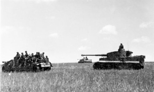 Soldiers of the Waffen-SS advance in armoured vehicles during Operation Citadel, Russia June 1943.