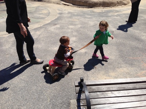 This random little boy hopped on Chloe's scooter today in the park.  She loved it.  She pulled him around for a bit.