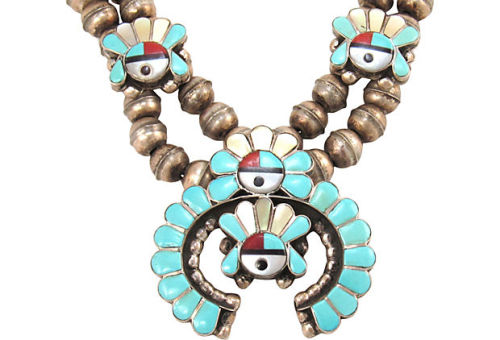 "Rare Zuni squash blossom necklace with sunface design with turquoise, abalone, coral and jet. Zuni inlay using both stone on stone and channel set techniques. Naja or central crescent pendant, 1 1/2""W x 1 3/8""H; smaller sunbonnets, 1/2""W x 3/8""H.  by Ruby + George on One Kings Lane Vintage and Market Finds"