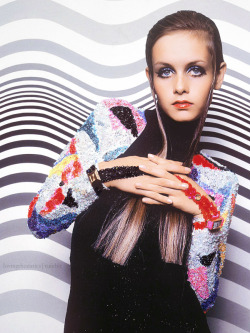 lovingthesixties:  Twiggy in front of a Bridget Riley painting photographed by Bert Stern for Vogue 1967.