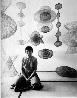 design-voyager:  Ruth Asawa with her wire sculptures.