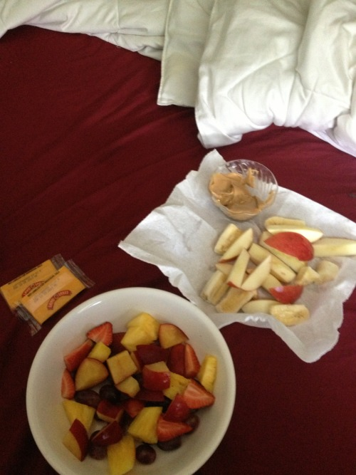I figure ill drown my sickness with healthy foods. My sick-girl lunch in bed includes two cheddar cheese slices, a pineapple, grape, plum, and strawberry salad, with a side of apple and banana plus peanut butter for dipping. Oh and can't forget law and order Svu for entertainment. If I weren't hacking up a lung I'd consider this heaven.