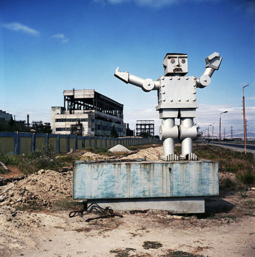 architectureofdoom:  From Caspian Dreams, Azerbaijan, James Pomerantz. A robot statue marks the entrance to a factory in the former soviet chemical production town of Sumqayit, one of the ten most polluted places on earth.