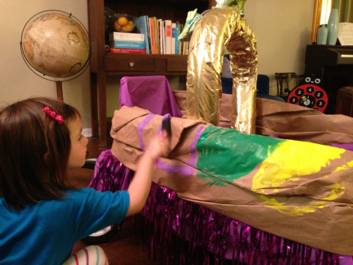 Working on the king cake paint job for her school Mardi Gras float.