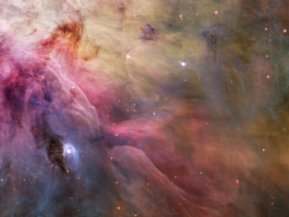 cozydark:  Adrift in Orion's stellar nursery and still in its formative years, variable star LL Orionis produces a wind more energetic than the wind from our own middle-aged Sun. As the fast stellar wind runs into slow moving gas a shock front is formed, analogous to the bow wave of a boat moving through water or a plane traveling at supersonic speed.
