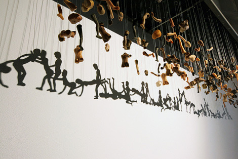 thekhooll:  Unity Virginia-based Korean artist Bohyun Yoon's suspended installation, Unity, takes fragmented pieces of dolls, hangs them in midair, and gives them suggestive shadow forms. It's a genius plan that has been executed perfectly. The body parts alone create a slightly disturbing environment, but the shadows transform the piece into something much more provocative and meaningful.